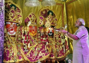 Gujarat Chief Minister Narendra Modi performs worship of Lord Jagannath, Balbhadra and Subhadra at Lord Jagannath temple on the eve of the annual Rathyatra festival in Ahmedabad on Saturday.