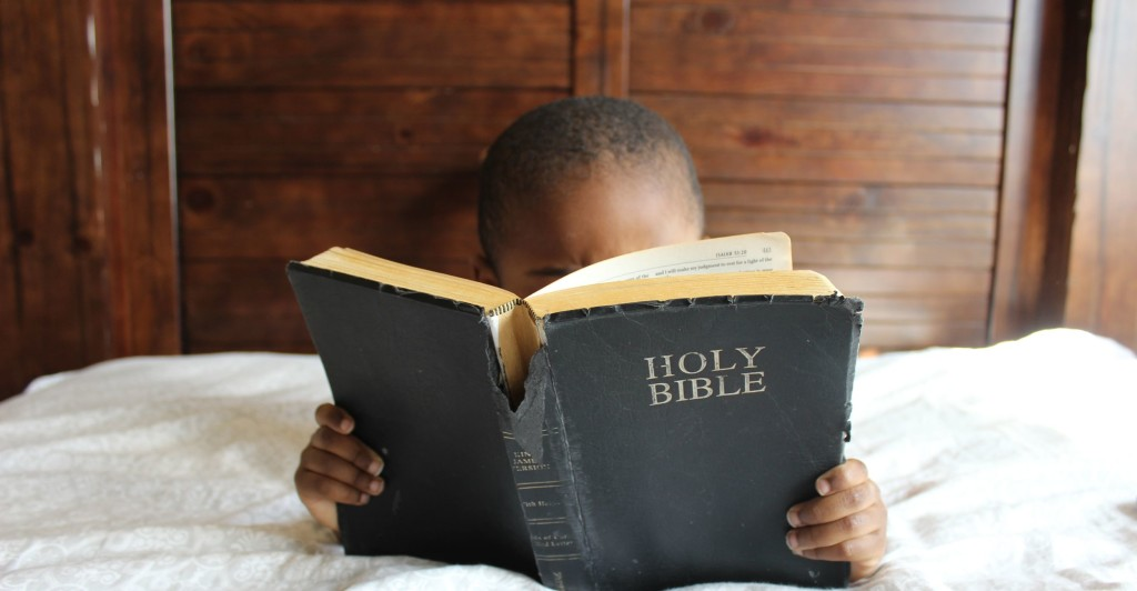Little boy and bible
